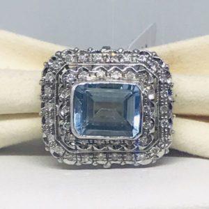 anello oro bianco con pietra preziosa azzurro trasparente gioielli torino