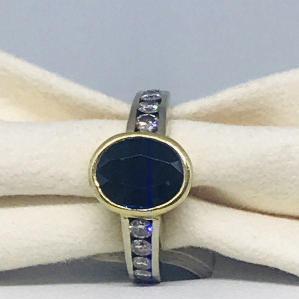 Anello con zaffiro e diamanti ct  0,30