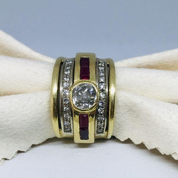 Anello con diamante taglio antico ct 0,63 e rubini