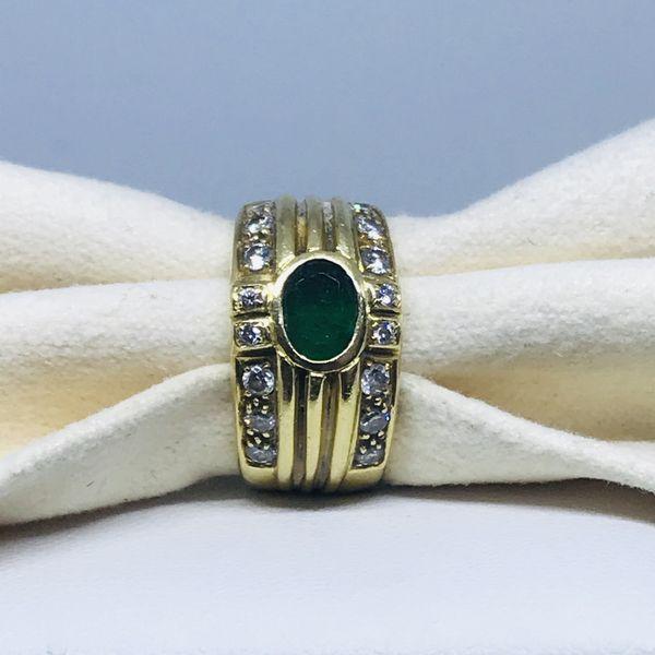 Anello a fascia con smeraldo e diamanti ct 0,32