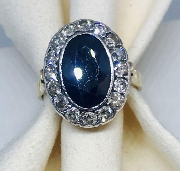 Anello stile antico con diamanti ct 0,80 e zaffiro