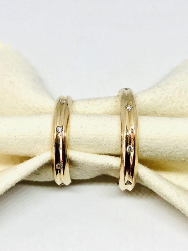 coppia di fedi in oro giallo con pietre preziose gioielli torino