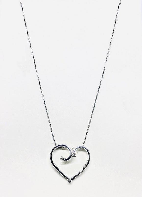 Collana con ciondolo a cuore e diamanti ct 0,24