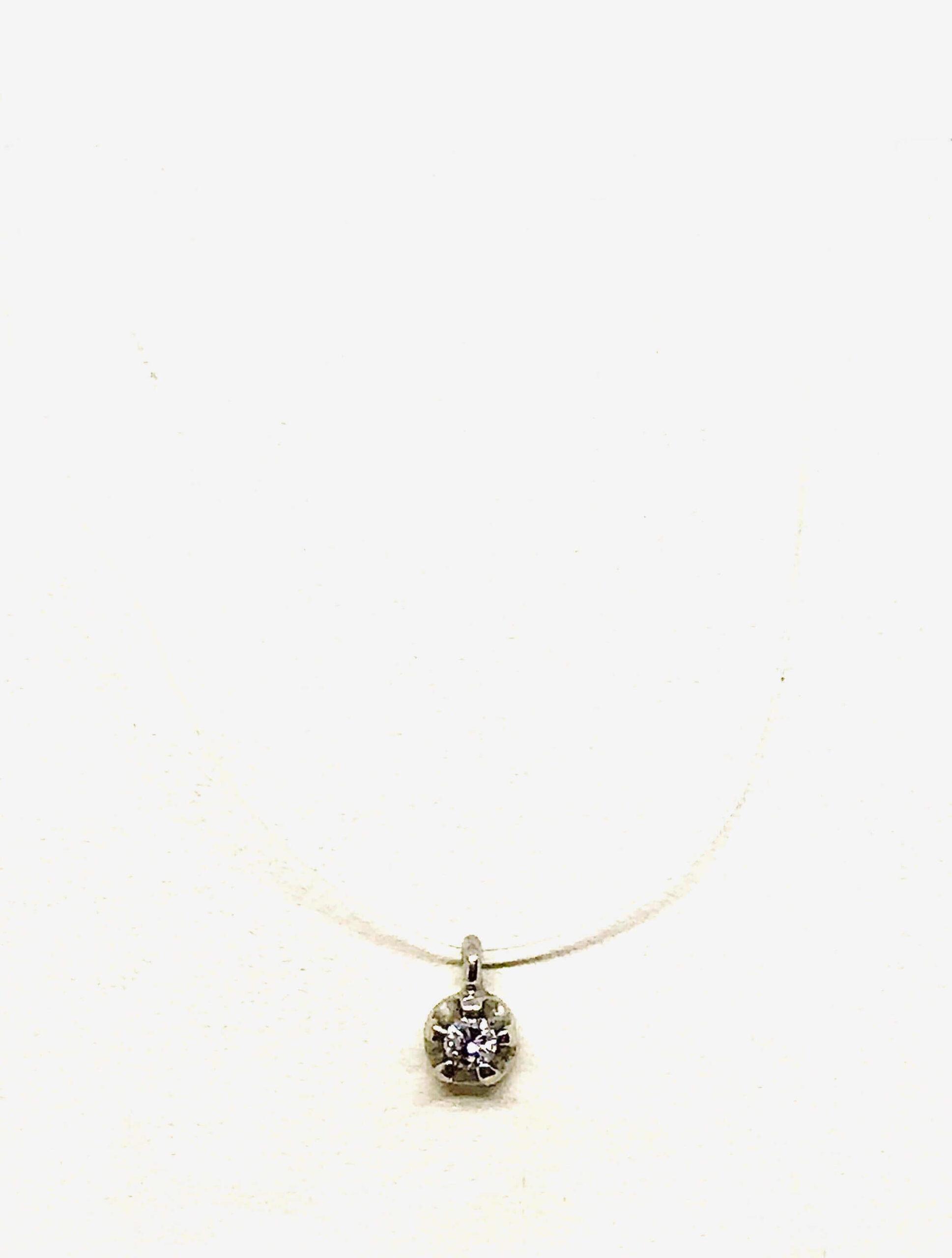 Collana punto luce filo invisibile con diamante ct 0,02