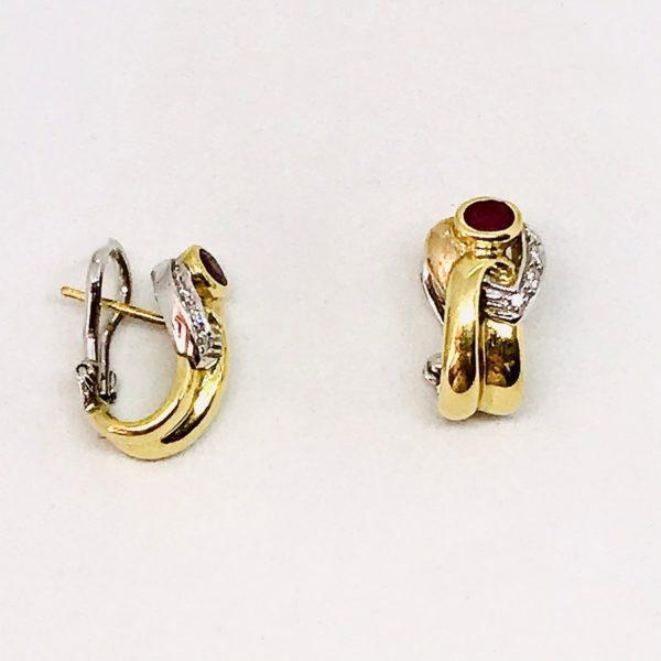 orecchini in oro con pietra nera gioielli torino
