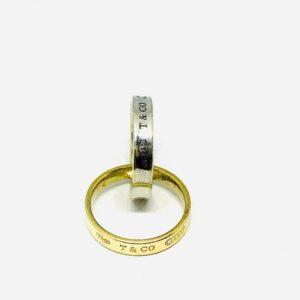 anello in oro giallo e bianco Tiffany & Co. 18 carati modello intrecciato. Offerte d'oro Gioielli Torino.
