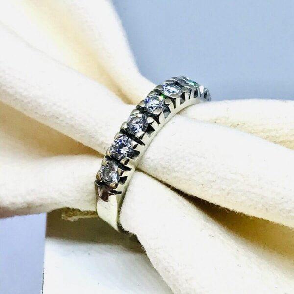 Anello in oro bianco 18 carati con cinque diamanti. Offerte d'oro Gioielli Torino.