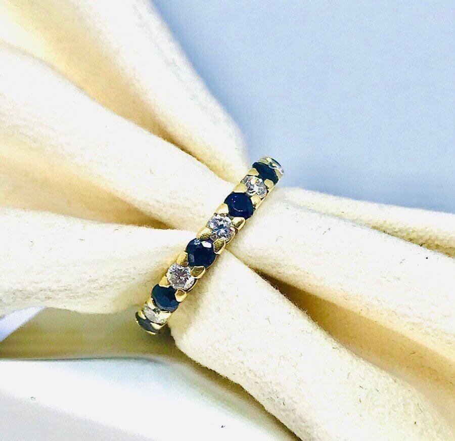 Anello Riviera con diamanti e zaffiri ct 0,66